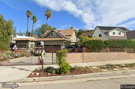Property photo for 21447 Mulholland Drive, Woodland Hills, CA 91364 .